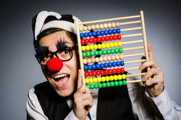 Wall Mural - Funny clown with abacus in accounting concept