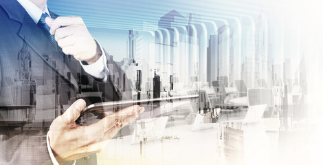 Double exposure of  businessman shows modern technology as conce