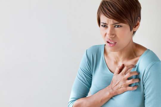 sick woman with sudden heart attack symptom