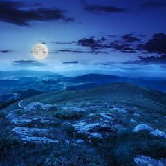 light on stone mountain slope at night