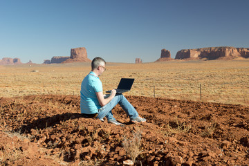 Business man in Monument Valley