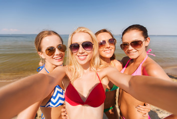 group of young smiling women making selfie