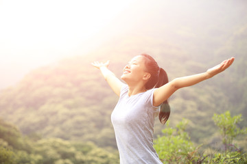 cheering hiking woman open arms mountain peak