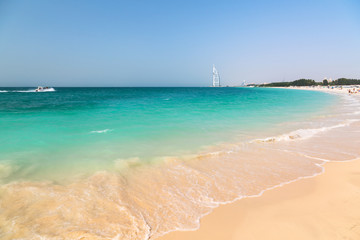 Public beach with turquoise water in Dubai, UAE