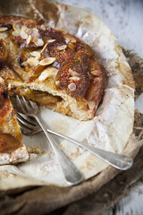 rustic stuffed figs pie covered with almonds and candied figs