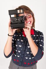 Cute nerdy girl taking a selfie picture.