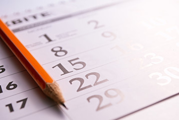 Close-up of a pencil on the page of a calendar