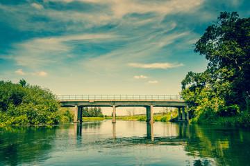 River landscape with a small bridge