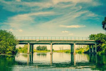Small bridge over a beautiful lake