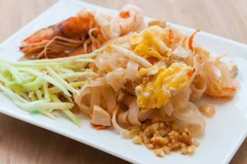 Seafood pad Thai dish of stir fried rice noodles