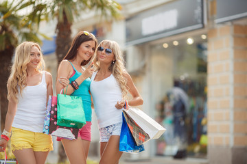 Three girls with shopping bags and go shopping.