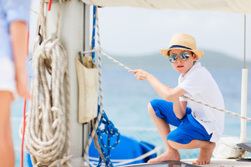 Teenage boy at luxury yacht