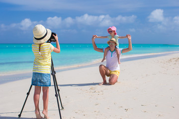 Little cute girl making photo of her family