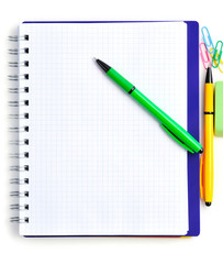 Notebook with color pens on a white background