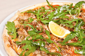 Pizza with panchetta and mushrooms