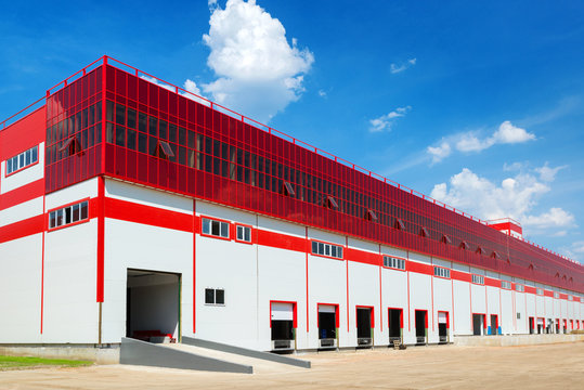 Big modern warehouse exterior, commercial industrial building for logistics