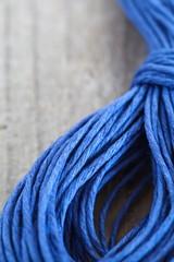 Close - up blue hemp ropes on wooden background