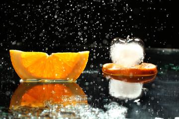 mandarin oranges and cloves on blurred background freshness