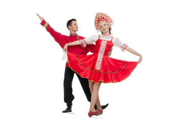 Couple of dancers in russian traditional costumes.