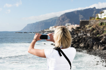 Woman taking picture on mobile phone at Tenerife