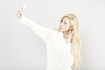 Woman taking a self portrait
