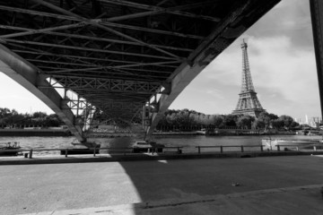 Streets of Paris with Eiffel Tower view from under the bridge