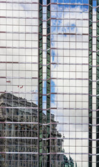Building reflection on glass steel facade