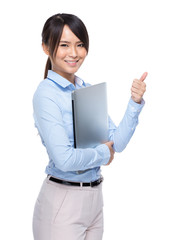 Businesswoman with laptop computer and thumb up