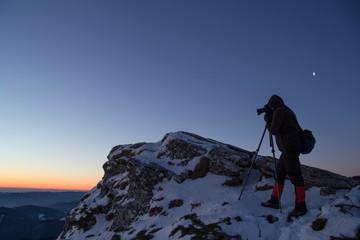 Nature and landscape photographer at sunrise