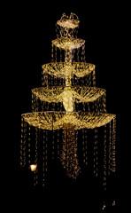Shiny street decoration at christmas time against black backgrou
