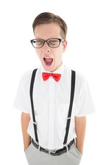Nerdy hipster yawning in suspenders and bow tie