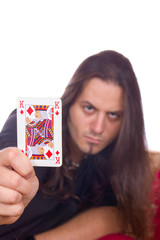 man shows the king of spades