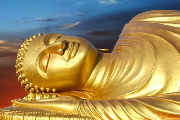 reclining Buddha on sunset