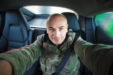 man self-portrait in the car