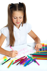 A beautiful girl in a school form drawing a marker, on a white