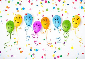 Bunte Smiley-Luftballons mit Konfetti