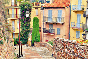 Street with buildings and paved brick walkway in Cannes, France