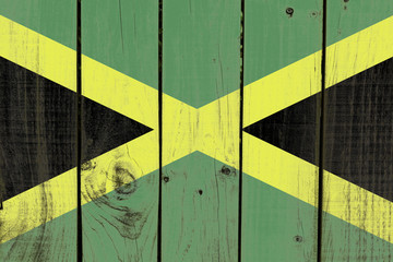Jamaica flag on wooden background