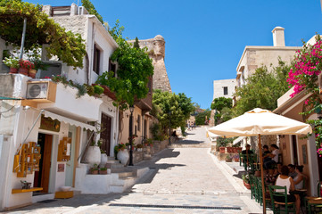 Tourists have a rest in the old town of Rethymno. Crete, Greece.