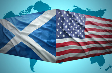 Waving Scottish and American flags