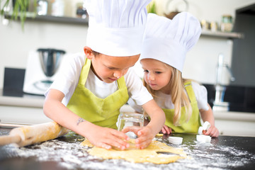 happy childrens kids family preparing funny cake kitchen at home