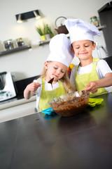 happy children kids family preparing funny cake kitchen at home