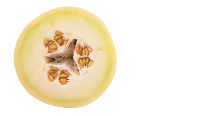 Slice of honeydew fruit over white background