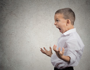 Angry Boy Screaming, side view profile, grey wall background