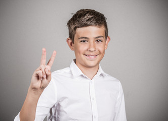 Young man showing number two sign, peace gesture