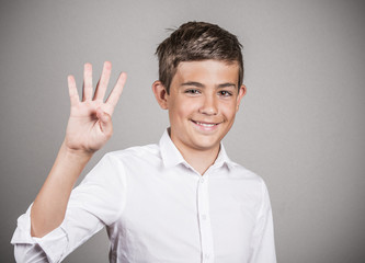 Handsome teenager showing four fingers, number 4 gesture