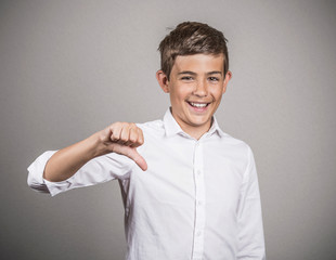 Happy young guy giving thumbs down gesture