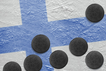Finnish flag and washers on the ice