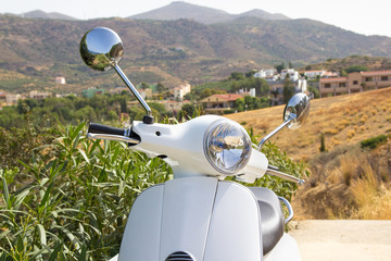 white retro scooter in mountains of Greece