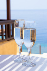 glasses of champagne on terrace with sea view